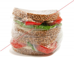 5383329 - tuna sandwich in plastic wrap isolated on white